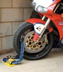 Motorcycle chained to Ground Anchor