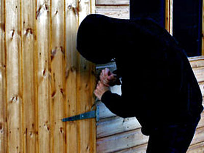 Burglar Breaking Into A Shed .